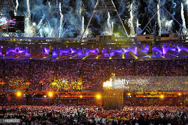 Flames leap from the cauldron and fireworks explode during the Opening Ceremony of the London 2012 Olympic Games at the Olympic Stadium on July 27...
