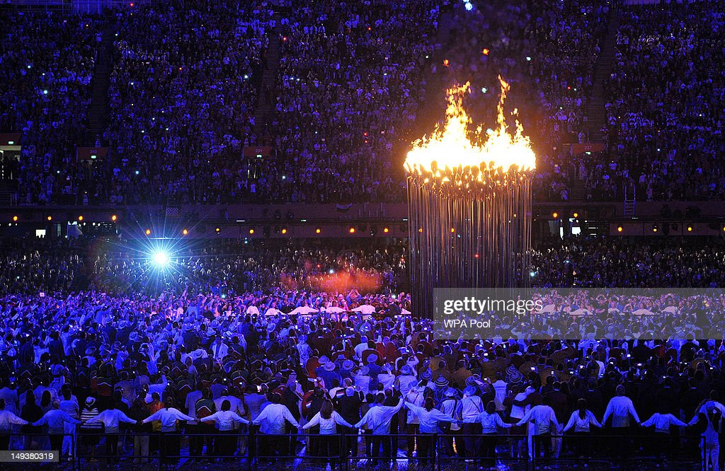 Flames leap from the cauldron during the Opening Ceremony of the London 2012 Olympic Games at the Olympic Stadium on July 27, 2012 in London, England.