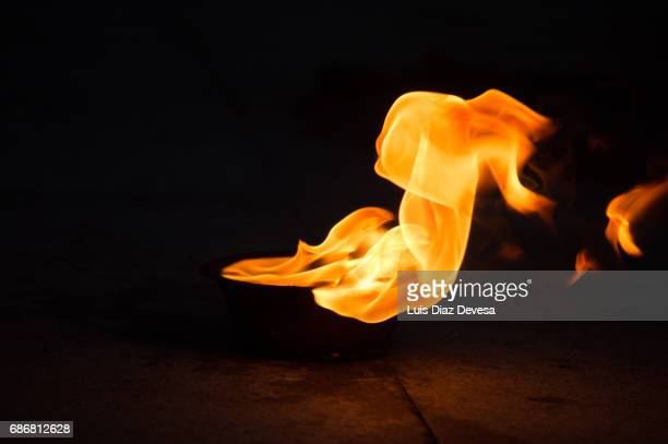 Flames of orange  reflections on a black background color