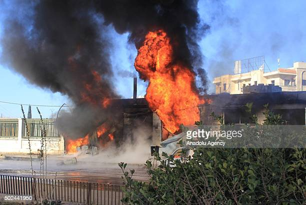 Flames rise after the war crafts belonging to the Russian army carried out airstrikes on two hospital in the Azaz town of Aleppo Syria on December 25...