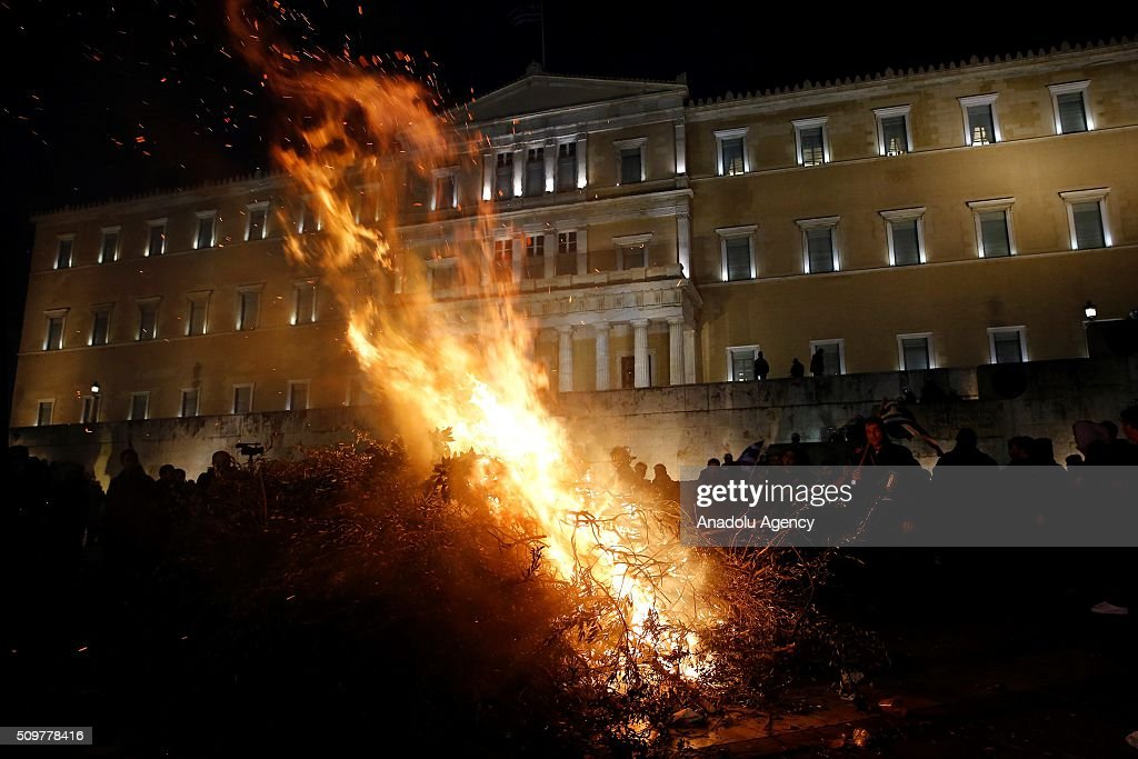 Flames rise as Greek farmers stage a rally against pension reform in front of the Greek parliament at the Syntagma Square in Athens on February 12, 2016.
