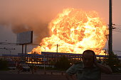 Flames rise from a petrochemical plant on July 16 2015 in Rizhao China A fire caused by a liquefied hydrocarbon leak broke out at around 740 am on...