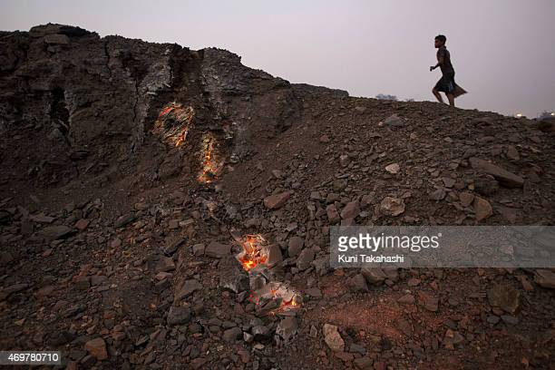 Flames rise from an underground coal seam fire in Bokapahari in Dhanbad Jharkhand India on December 6 2014 Underground fires are a major threat of...