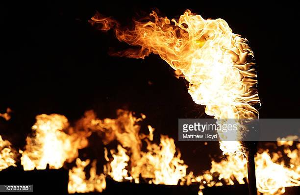 Flames rise from burning bonfires and stakes during the Allendale Tar Barrel festival on December 31 2010 in Allendale England An annual event since...