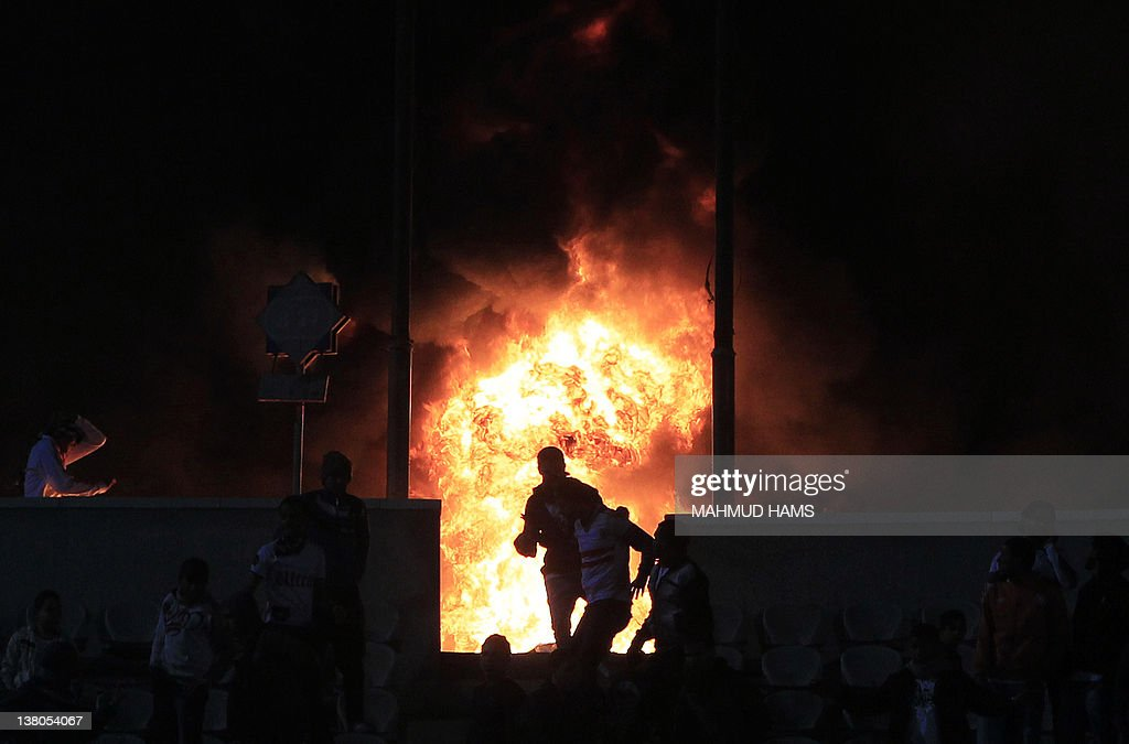 Flames rise from Cairo Stadium during the first half of a match between Zamalek and Ismaili clubs in Cairo on February 1 2012 At least 73 people were...