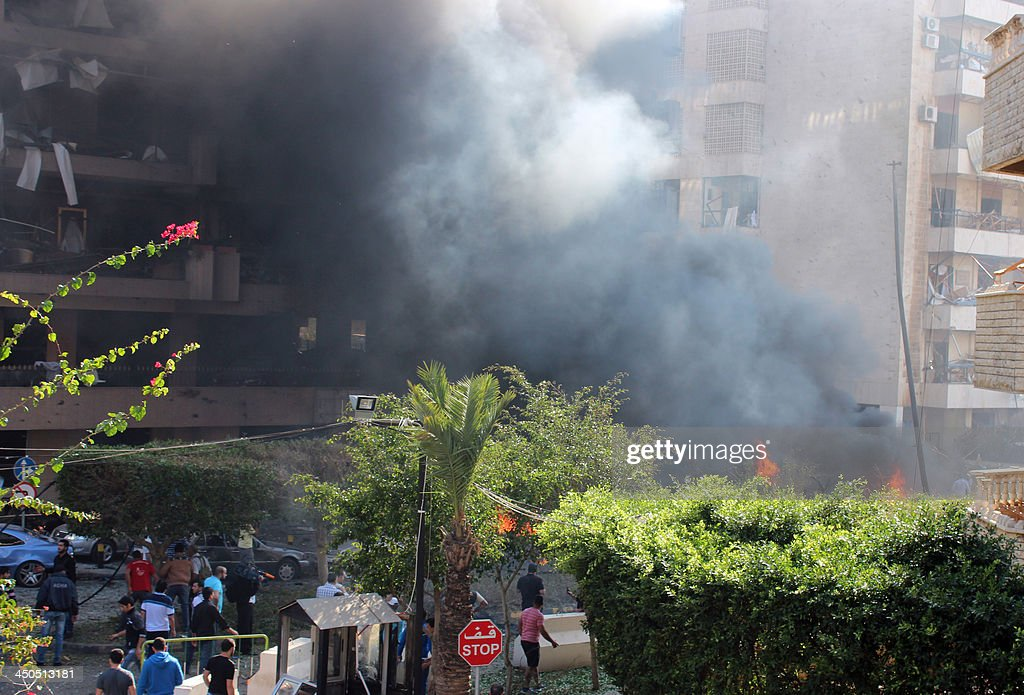 Flames rise from the site of a blast in Bir Hassan neighbourhood in the southern Beirut on November 19, 2013. At least 22 people were killed in a double bomb attack outside the Iranian embassy in Beirut, including an Iranian cultural advisor, government sources told AFP.
