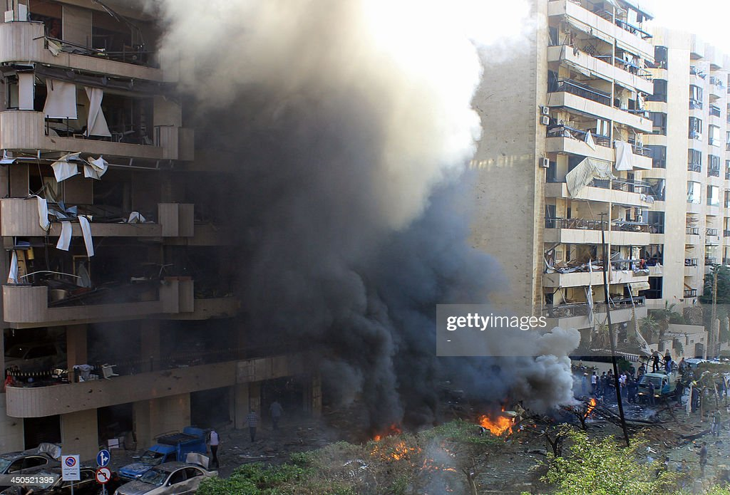 Flames rise from the site of a blast in Bir Hassan neighbourhood in southern Beirut on November 19, 2013. At least 22 people were killed in a double bomb attack outside the Iranian embassy in Beirut, including an Iranian cultural advisor, government sources told AFP.