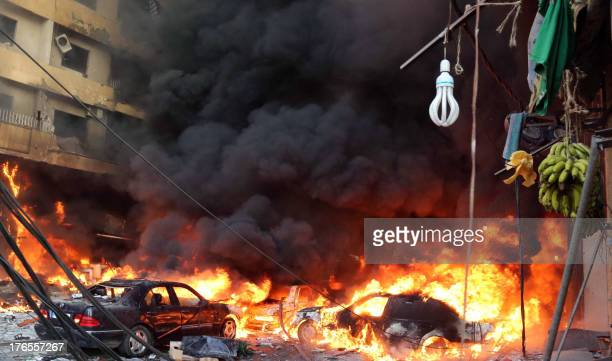 Flames rise from the site of a car bomb between the Bir elAbed and Roueiss neighbourhoods in the southern suburb of Beirut on August 15 2013 A...