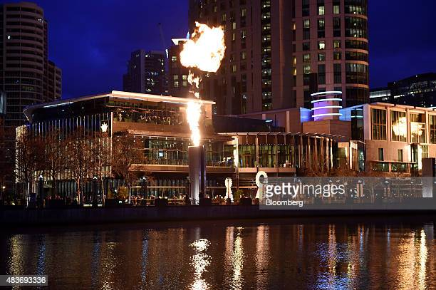 Flames shoot from pillars during the Gas Brigade fire show at Crown Resorts Ltd's Crown Melbourne casino and entertainment complex along the Yarra...