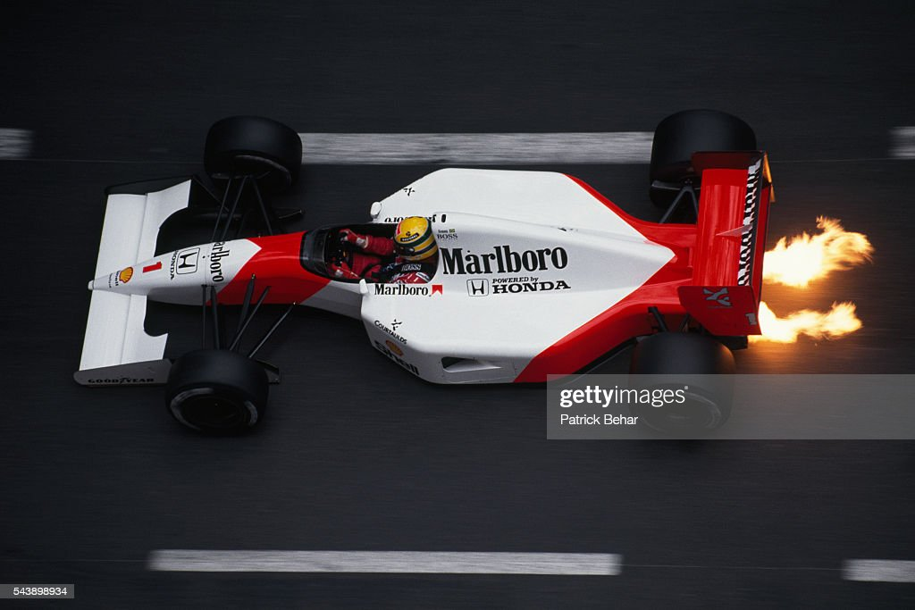 Flames shoot out from under the Formula One racecar of driver Ayrton Senna, of the McLaren-Honda racing team, during the 1991 Monaco Grand Prix.