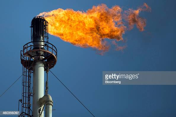 Flames shoot out of one of the flare stacks at the Petroleos Mexicanos Miguel Hidalgo Refinery in Tula de Allende Mexico on Thursday March 6 2014 Oil...