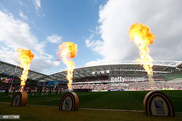 Flames shoot up as the teams enter the field ahead of the 2015 Rugby World Cup Pool B match between South Africa and Japan at the Brighton Community...