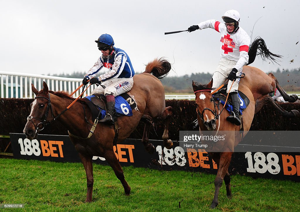 Flaming Charmer ridden by Richard Johnson(L) jumps the last to win the Midas Construction Handicap Chase at Exeter Racecourse on December 15 2016 in Exeter, England.