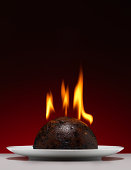 Christmas Pudding on fire with a red Background