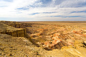 Edge of the Flaming Cliffs of Bayanzag famous for dinosaur egg discovery in the Gobi Desert of Mongolia