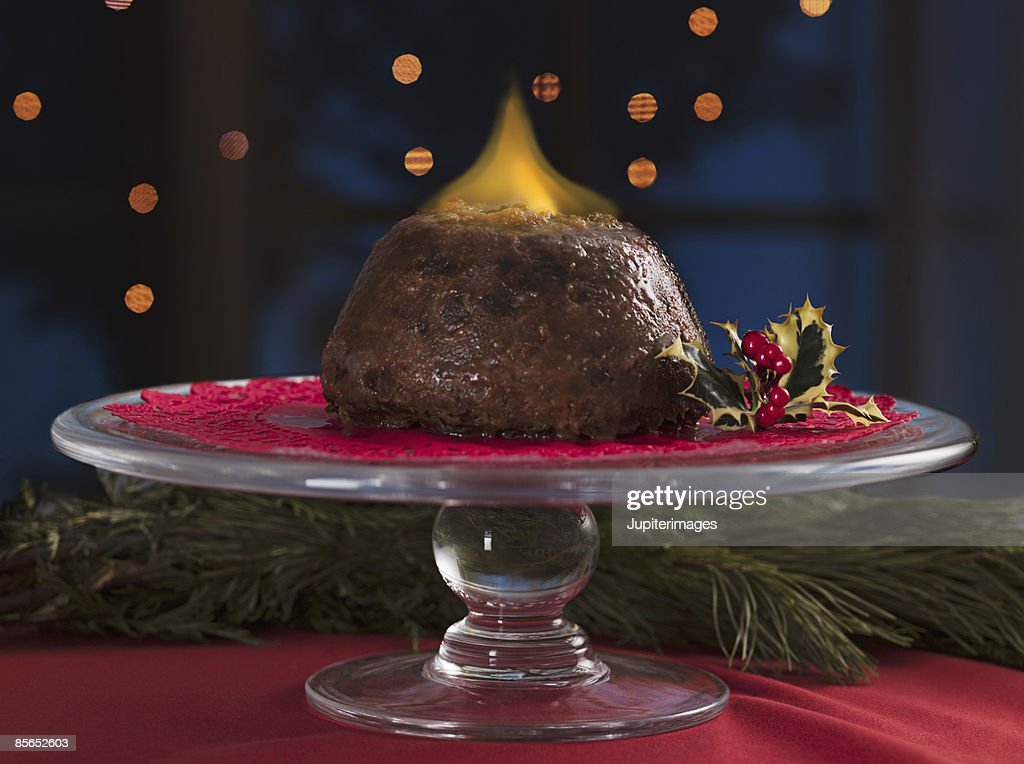 Flaming English Christmas pudding : Stock Photo