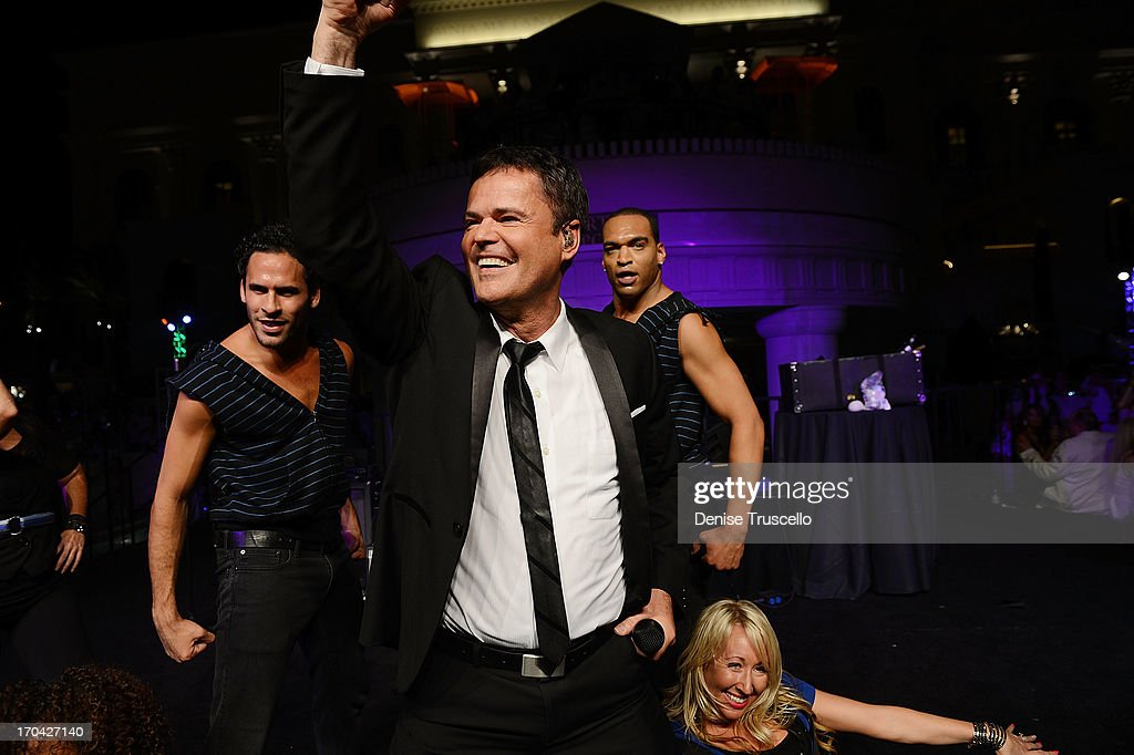 Flamingo Las Vegas headliner <a gi-track='captionPersonalityLinkClicked' href=/galleries/search?phrase=Donny+Osmond&family=editorial&specificpeople=214564 ng-click='$event.stopPropagation()'>Donny Osmond</a> performs at the closing night party for IPW 2013 at the Garden for the Gods pool at Caesars Palace on June 12, 2013 in Las Vegas, Nevada.