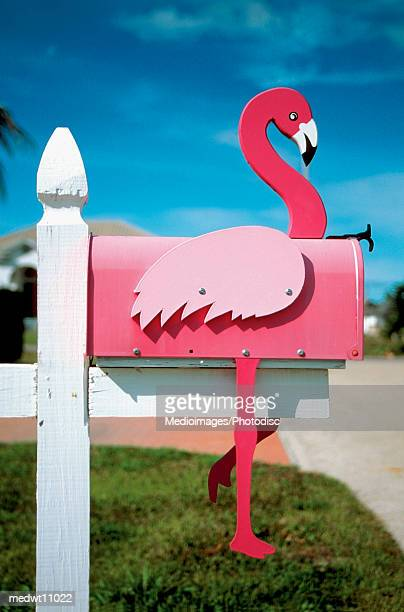 Flamingo made of wood attached to pink mailbox on Sanibel Island, Florida, USA