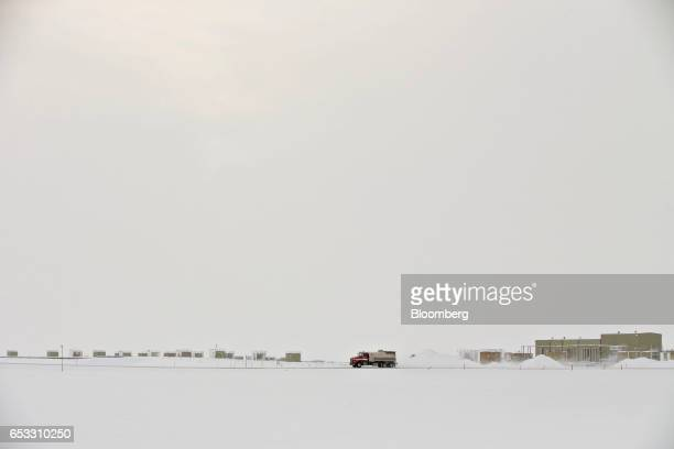 A flammable liquids tanker travels on a road near oil well pump houses in Prudhoe Bay Alaska US on Thursday Feb 16 2017 Four decades after the Trans...