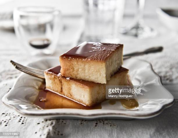 Flan on plate with syrup and fork