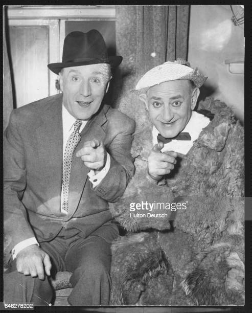 Flanagan and Allen in costume in their dressing room at the London Palladium where they performed a song for the Ealing Studios film Dunkirk 1957