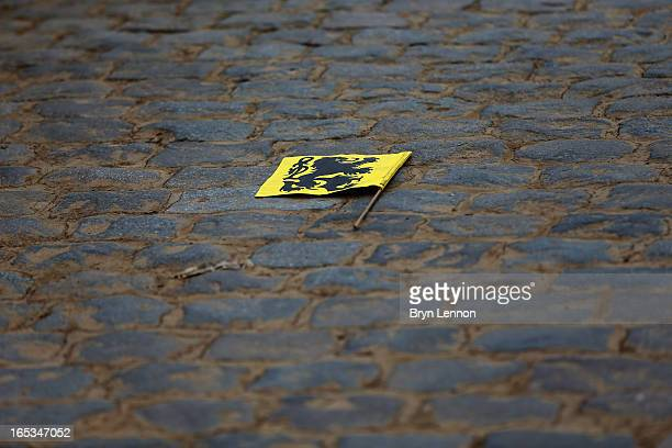 Flanders flag lies on the cobbles during the 97th Tour of Flanders from Brugge to Oudenaarde on March 31 2013 in Bruges Belgium