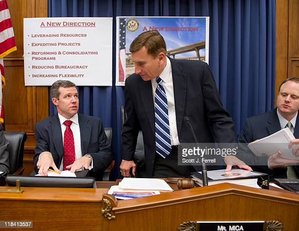 Flanked by aides House Transportation Chairman John L Mica RFla takes his seat for a news conference in the committee hearing room introducing the...