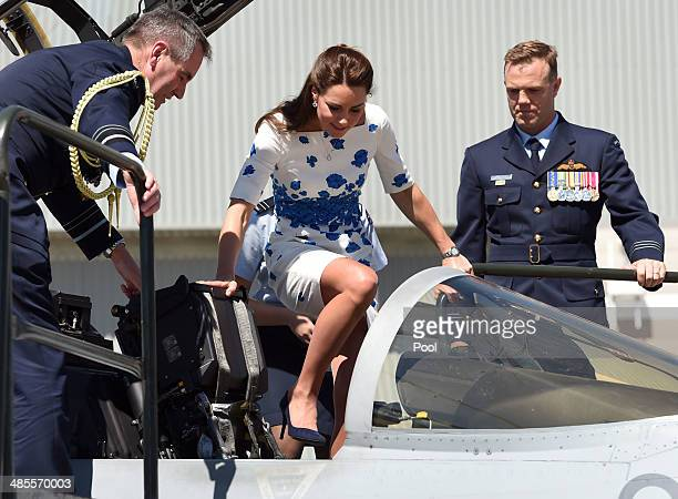 Flanked by Chief of Air Force Air Marshall Geoff Brown and Commanding Officer of Number 1 Squadron Wing Commander Stephen Chappell Catherine the...