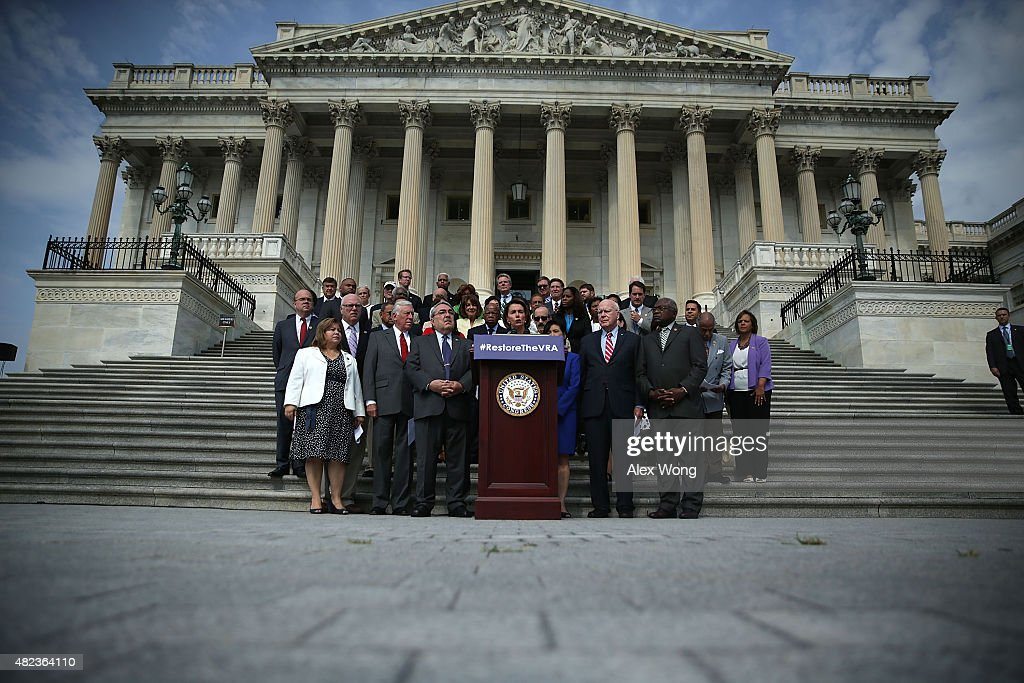 Flanked by Congressional members, U.S. House Democratic Leader Rep. <a gi-track='captionPersonalityLinkClicked' href=/galleries/search?phrase=Nancy+Pelosi&family=editorial&specificpeople=169883 ng-click='$event.stopPropagation()'>Nancy Pelosi</a> (D-CA) (C) speaks a rally in front of the U.S. Capitol July 30, 2015 on Capitol Hill in Washington, DC. House Democrats held the rally to commemorate the 50th anniversary of the Voting Rights Act.