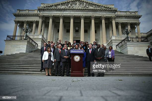 Flanked by Congressional members US House Democratic Leader Rep Nancy Pelosi speaks a rally in front of the US Capitol July 30 2015 on Capitol Hill...
