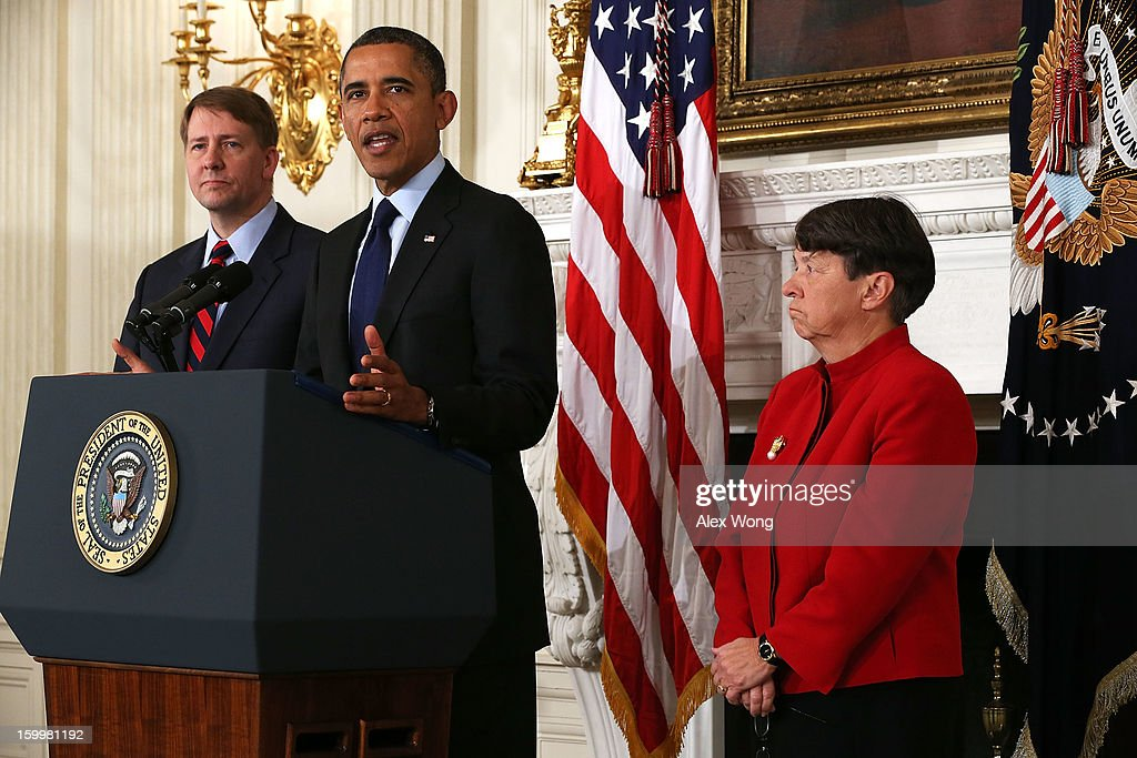 Flanked by Director of the United States Consumer Financial Protection Bureau Richard Cordray (L) and former U.S. Attorney for the Southern District of New York Mary Jo White (R), U.S. President Barack Obama makes a personnel announcement at the State Dining Room of the White House January 24, 2013 in Washington, DC. President Obama nominated Mary Jo White to become the new Chairwoman of Securities and Exchange Commission. He also re-nominated Richard Cordray for the same position Cordray has been holding.