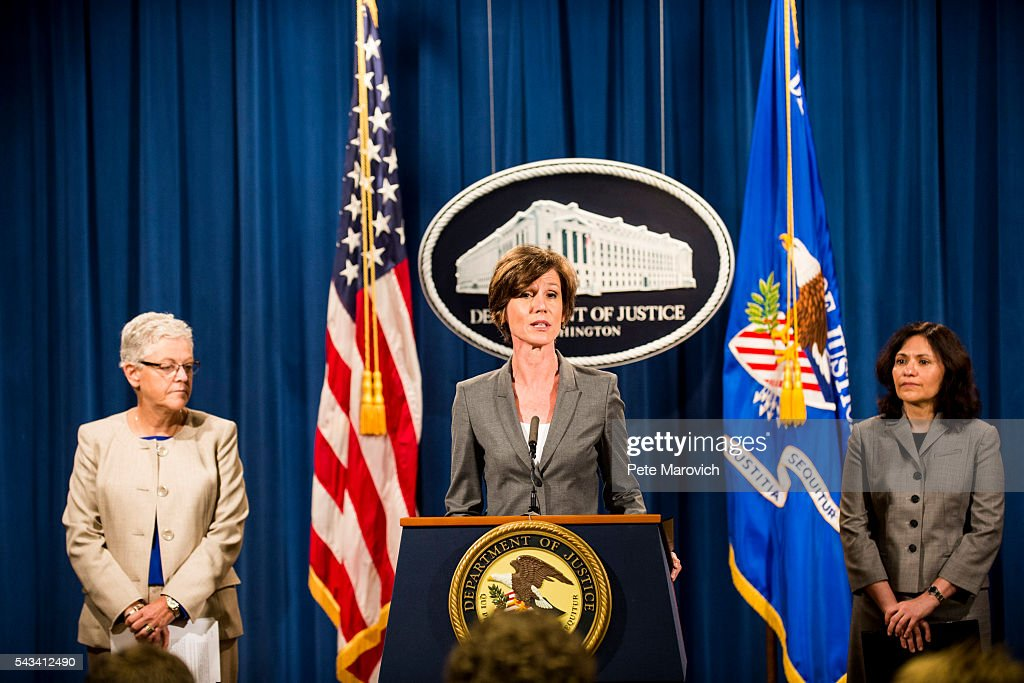 Flanked by Environmental Protection Agency Administrator Gina McCarthy and Federal Trade Commission Chairwoman Edith Ramirez , Deputy Attorney General Sally Q. Yates speaks during a press conference at the Department of Justice on June 28, 2016 in Washington, DC. Volkswagen has agreed to nearly $15 billion in a settlement over emissions cheating on its diesel vehicles.
