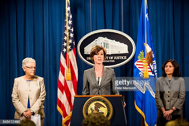 Flanked by Environmental Protection Agency Administrator Gina McCarthy and Federal Trade Commission Chairwoman Edith Ramirez Deputy Attorney General...