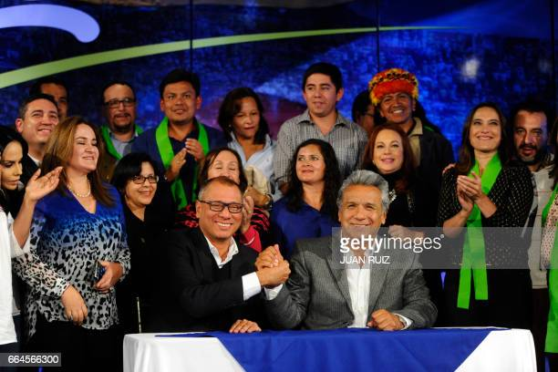 Flanked by family and members of their campaign team Ecuadorean Presidentelect Lenin Moreno and his runningmate Jorge Glas receive the final official...