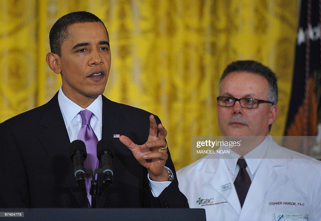 Flanked by healthcare professionals, US President <a gi-track='captionPersonalityLinkClicked' href=/galleries/search?phrase=Barack+Obama&family=editorial&specificpeople=203260 ng-click='$event.stopPropagation()'>Barack Obama</a> speaks on healthcare reform in the East Room of the White House March 3, 2010 in Washington, DC. AFP PHOTO/Mandel NGAN