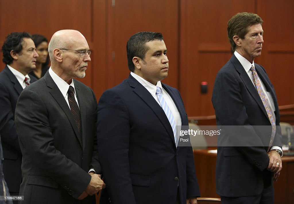 Flanked by his defense counsel, Don West (L) and Mark O'Mara, George Zimmerman stands as the selected jurors enter the courtroom to be sworn in, in Seminole circuit court June 20, 2013 in Sanford, Florida. Zimmerman is charged with second-degree murder for the February 2012 shooting death of 17-year-old Trayvon Martin.