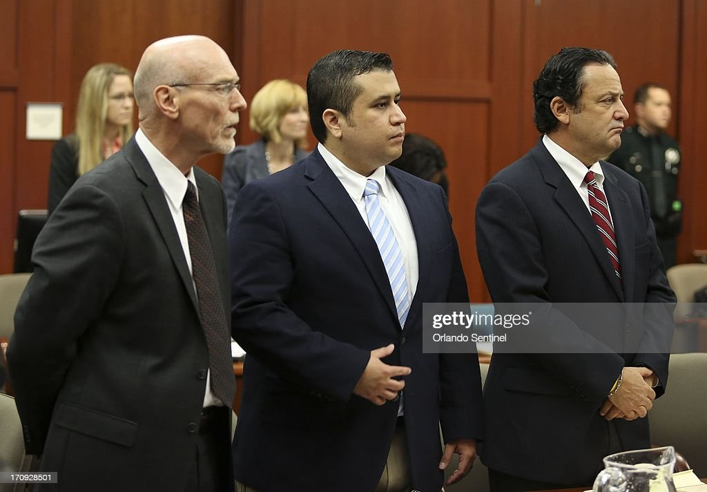 Flanked by his defense counsel, Don West, left, and jury consultant Robert Hirschhorn, George Zimmerman stands as potential jurors enter the courtroom for his trial in Seminole circuit court in Sanford, Florida, Thursday, June 20, 2013. Zimmerman has been charged with second-degree murder for the 2012 shooting death of Trayvon Martin.