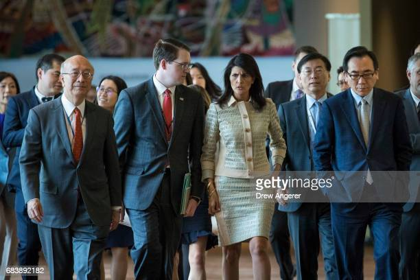 Flanked by Koro Bessho Japanese ambassador to the United Nations and Cho Taeyul South Korean Ambassador to the United Nations Nikki Haley US...