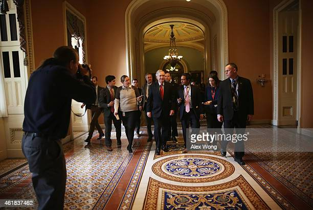 Flanked by members of the media US Senate Majority Leader Sen Mitch McConnell walks back to his office after the Senate Republican weekly policy...