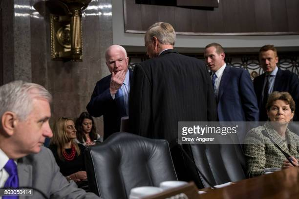 Flanked by ranking member of the committee Sen Jack Reed and Sen Jeanne Shaheen Committee chairman Sen John McCain talks with Sen Angus King before...