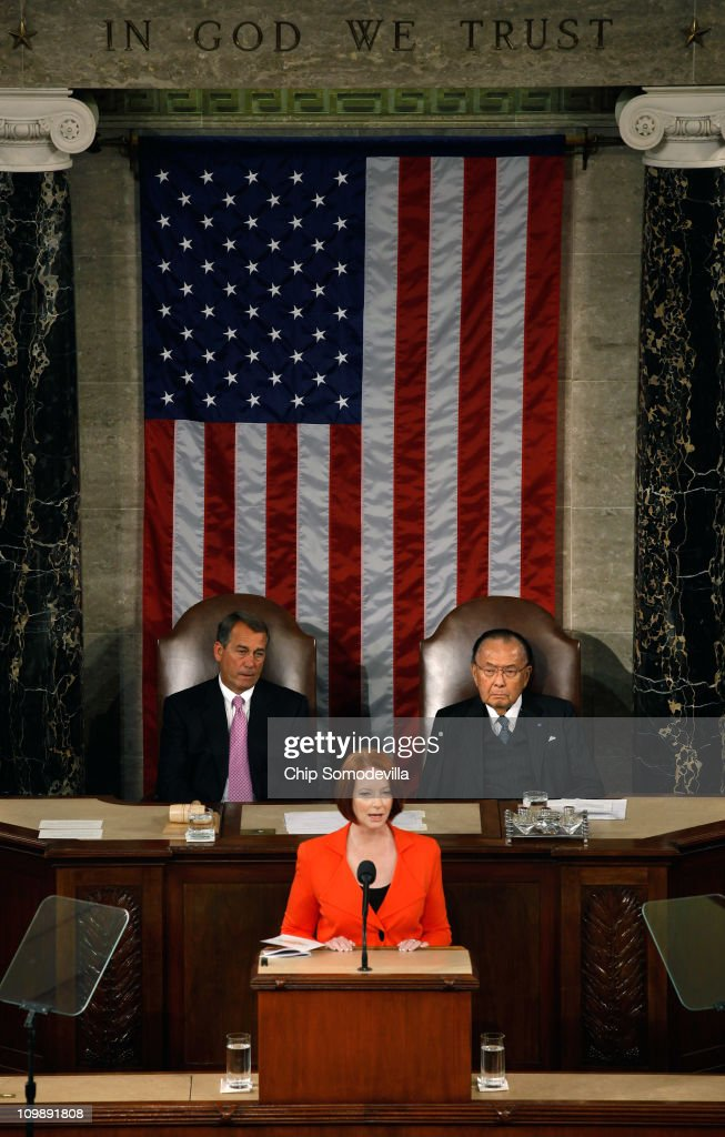 Flanked by Speaker of the House <a gi-track='captionPersonalityLinkClicked' href=/galleries/search?phrase=John+Boehner&family=editorial&specificpeople=274752 ng-click='$event.stopPropagation()'>John Boehner</a> (R-OH) (L) and Senate President Pro Tempe Daniel Inouye (D-HI), Australian Prime Minister <a gi-track='captionPersonalityLinkClicked' href=/galleries/search?phrase=Julia+Gillard&family=editorial&specificpeople=787281 ng-click='$event.stopPropagation()'>Julia Gillard</a> addresses a joint meeting of the U.S. Congress from the floor of the House of Representatives at the U.S. Capitol March 9, 2011 in Washington, DC. Gillard emphasized the long and strong bond between her country and the United States.