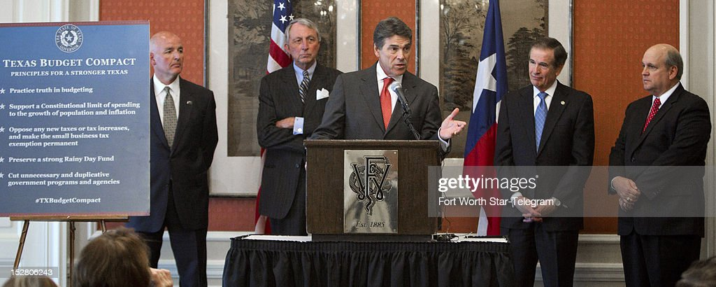 Flanked by state legislators, Texas Gov. Rick Perry speaks at a press conference at the Fort Worth Club to talk about the state budget on Wednesday, September 26, 2012, in Fort Worth, Texas.