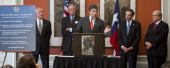 Flanked by state legislators Texas Gov Rick Perry speaks at a press conference at the Fort Worth Club to talk about the state budget on Wednesday...
