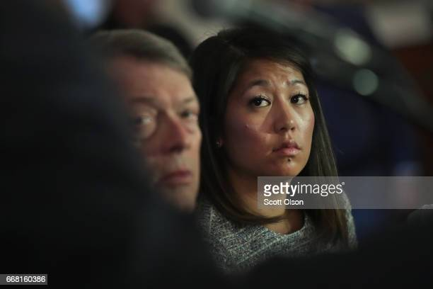 Flanked by Stephen Golan one of her father's attorneys Crystal Dao Pepper the daughter of Dr David Dao listens to questions during a press conference...