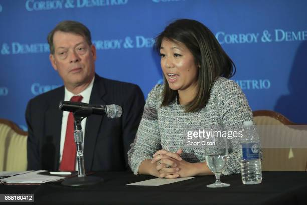Flanked by Stephen Golan one of her father's attorneys Crystal Dao Pepper the daughter of Dr David Dao speaks during a press conference on April 13...