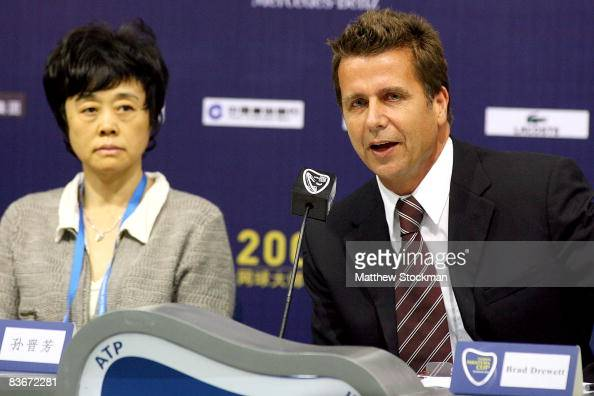 Flanked by Sun Jinfang tournament director Brad Drewett addresses the media at a press conference during the Tennis Masters Cup at Qi Zhong Stadium...