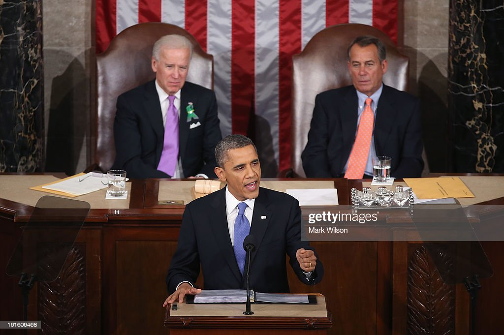 Flanked by U.S. Vice President Joe Biden (L) and Speaker of the House <a gi-track='captionPersonalityLinkClicked' href=/galleries/search?phrase=John+Boehner&family=editorial&specificpeople=274752 ng-click='$event.stopPropagation()'>John Boehner</a> (R), U.S. President <a gi-track='captionPersonalityLinkClicked' href=/galleries/search?phrase=Barack+Obama&family=editorial&specificpeople=203260 ng-click='$event.stopPropagation()'>Barack Obama</a> (C) delivers his State of the Union speech before a joint session of Congress at the U.S. Capitol February 12, 2013 in Washington, DC. Facing a divided Congress, Obama concentrated his speech on new initiatives designed to stimulate the U.S. economy and said, 'It's not a bigger government we need, but a smarter government that sets priorities and invests in broad-based growth'.