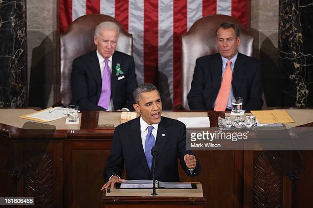 Flanked by US Vice President Joe Biden and Speaker of the House John Boehner US President Barack Obama delivers his State of the Union speech before...