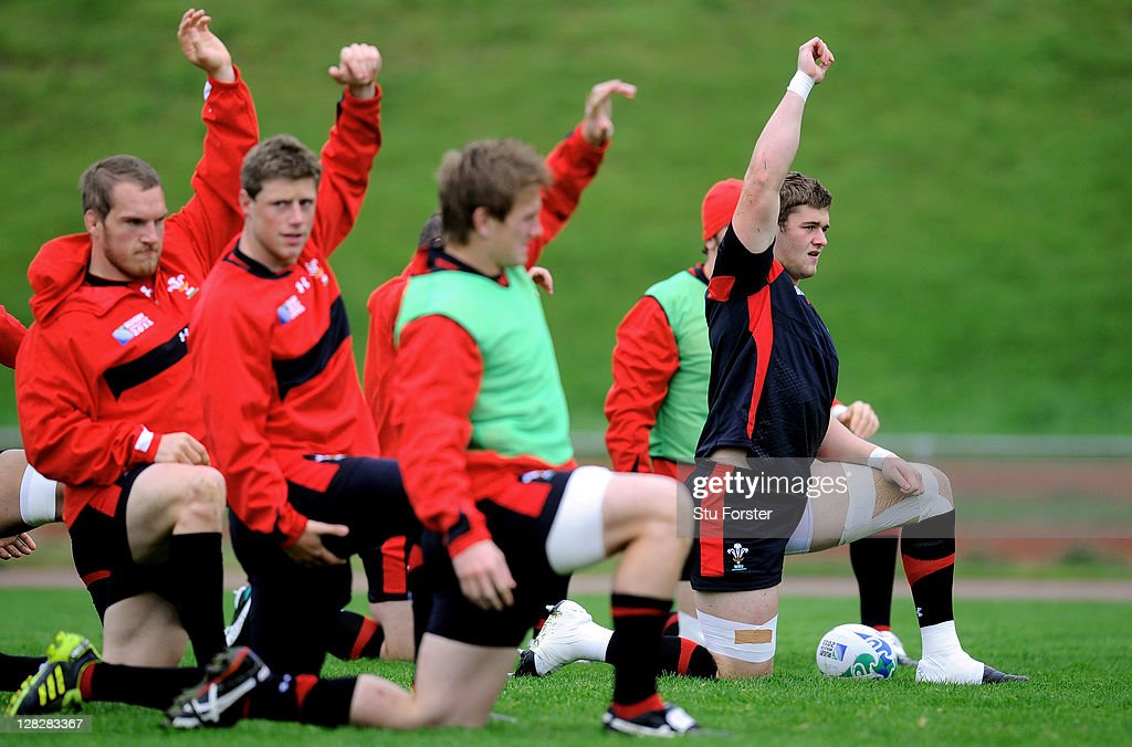 Flanker <a gi-track='captionPersonalityLinkClicked' href=/galleries/search?phrase=Dan+Lydiate&family=editorial&specificpeople=4598857 ng-click='$event.stopPropagation()'>Dan Lydiate</a> (R) stretches with teammates during a Wales IRB Rugby World Cup 2011 training session at Newtown Park on October 6, 2011 in Wellington, New Zealand.