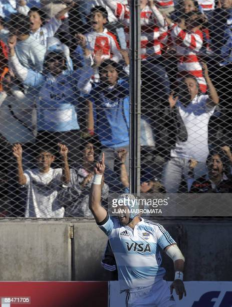 Flanker Juan Manuel Leguizamon of Argentina's Los Pumas celebrates after scoring a try against England during their second International Rugby Union...